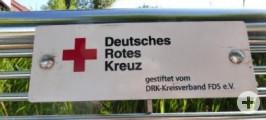 Sitzbank vom Deutschen Roten Kreuz in der Karl-von-Hahn-Straße